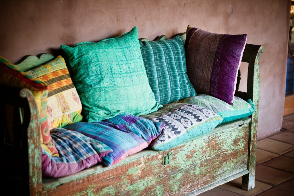 colorful pillows on old chair - look for smile